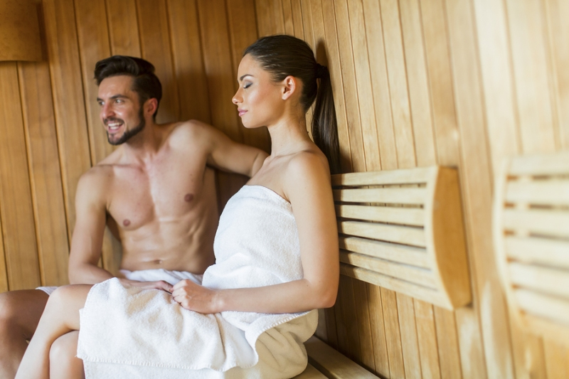A man and  woman inside a home sauna