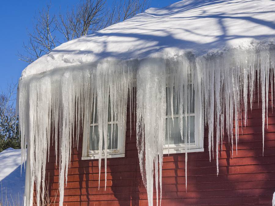 An ice dam on top of a residential roof