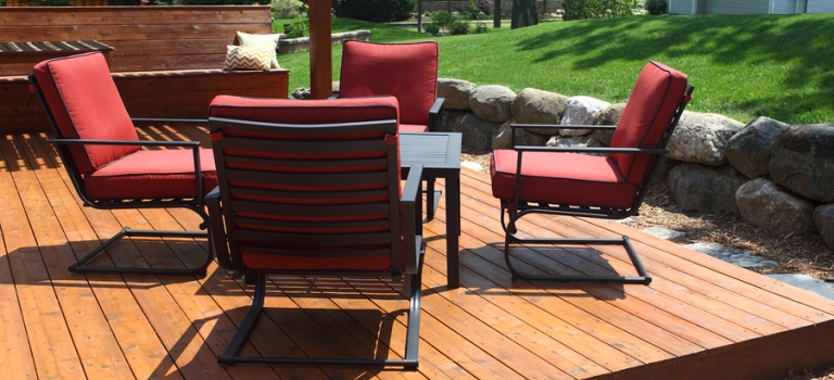An outdoor deck with plush furnishing