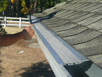High-tech gutter guard system being installed by contrator