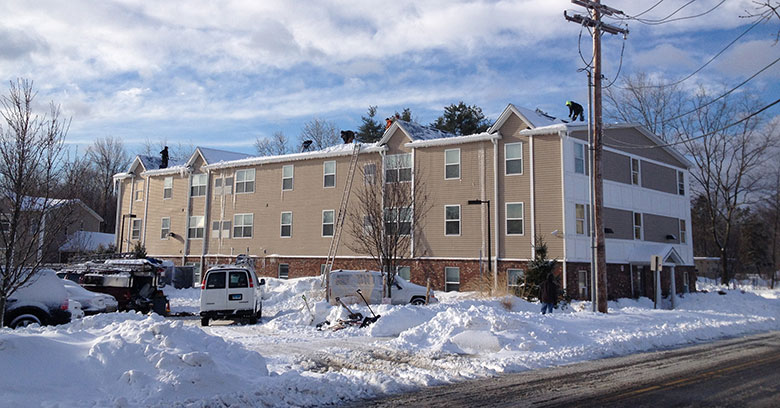 Commercial roof snow removal is necessary to avoid water damage, especially in hotel buildings with occupants.