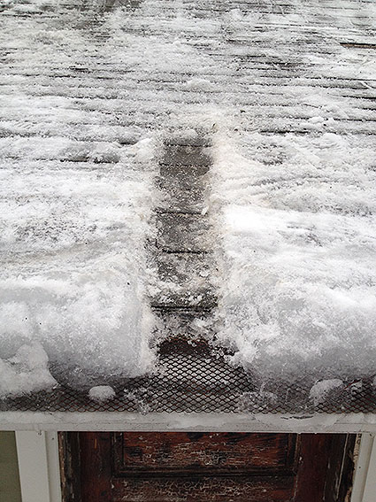 An ice dam formed on the roof of a residential home.