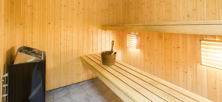 Interior of a Finnish sauna with seats and heating machine